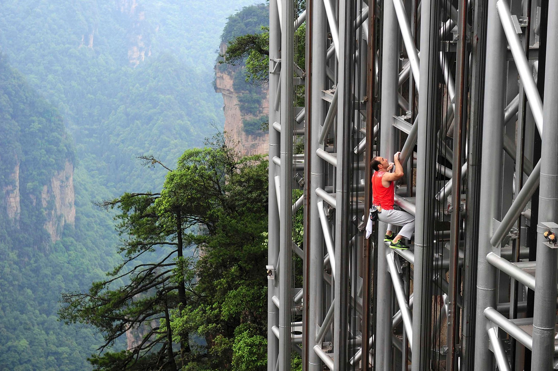 Frances-daredevil-climber-Jean-Michel-Casanova-climbs-the-Bailong-Elevator-near-a-cliff-in-Chinas-Hunan-province